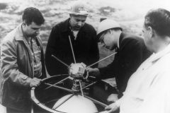A team of Vanguard I scientists mount the satellite in the rocket