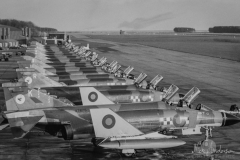 Phantom flightline No 43(F) Sqn lined up on the pan before the days of hardened aircraft shelters and dispersal areas. Some of the aircraft had curved tops to the fin as they were still unmodified and without Radar Warning Receivers. A crew is busy arming a Quick Reaction Alert aircraft prior to putting it 'on state' for QRA.
