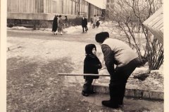 Irkutsk 2/1989 It was interesting to see how the soviet people interacted, in spite of age. I believe the 2 were stranger's, but the boy went up to talk to this street sweeper... and he stopped to listen and answer.